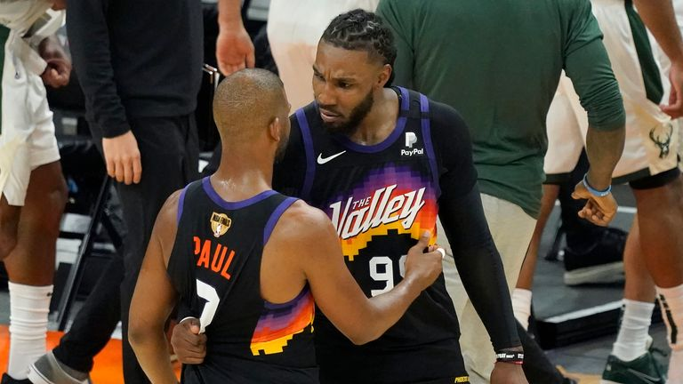 Phoenix Suns guard Chris Paul, left, celebrates with Jae Crowder after the Suns defeated the Milwaukee Bucks in Game 2 of basketball...s NBA Finals, Thursday, July 8, 2021, in Phoenix. (AP Photo/Matt York)
