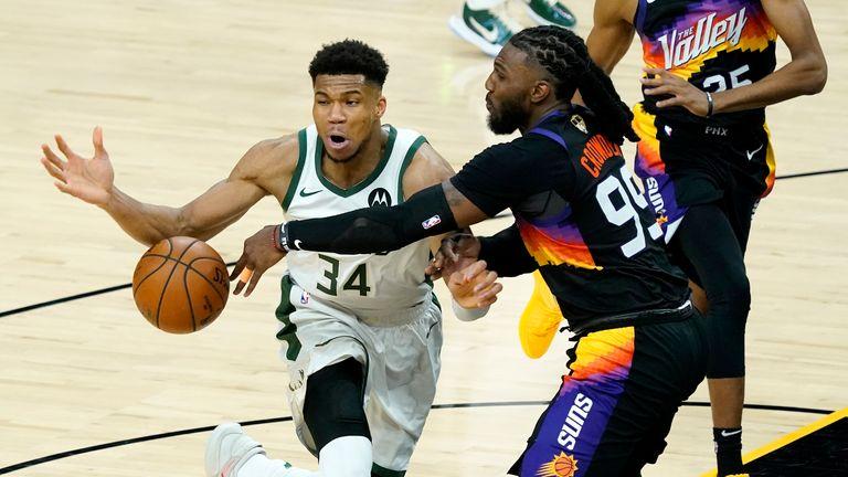 Phoenix Suns forward Jae Crowder (99) knocks the ball away from Milwaukee Bucks forward Giannis Antetokounmpo (34) during the second half of Game 1 of basketball...s NBA Finals, Tuesday, July 6, 2021, in Phoenix. (AP Photo/Matt York)