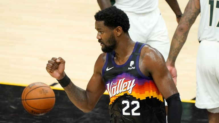 Phoenix Suns center Deandre Ayton (22) reacts during the first half of Game 2 of basketball's NBA Finals against the Milwaukee Bucks, Thursday, July 8, 2021, in Phoenix. (AP Photo/Matt York)