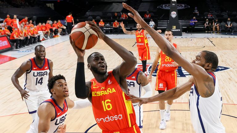 Usman Garuba attempts to shoot over Kevin Durant during an Olympic warm-up game between Spain and the USA