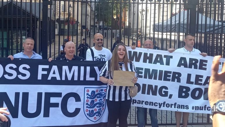 Holly Blades and Newcastle supporters protest outside Downing Street
