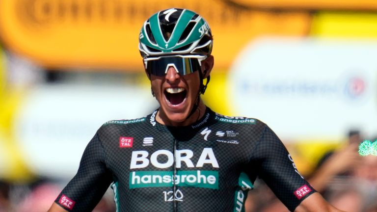 Nils Politt celebrates as he crosses the finish line to win the 12th stage of the Tour de France. (AP Photo/Daniel Cole)