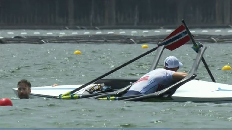 Norway's Kristoffer Brun and Are Weierholt Strandli capsize during the Olympic rowing regatta in Tokyo