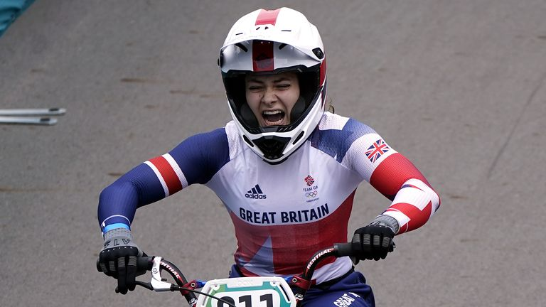 Bethany Shriever celebrates after winning gold for Team GB in the BMX cycling at Tokyo 2020.