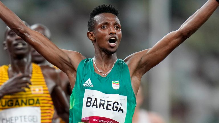 Selemon Barega, of Ethiopia, celebrates after winning the men's 10,000M