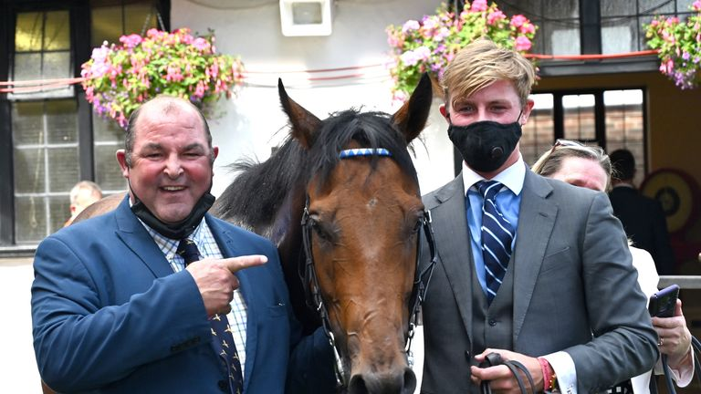 Harry Teal, right, with Oxted and trainer Roger after winning the July Cup at Newmarket last year