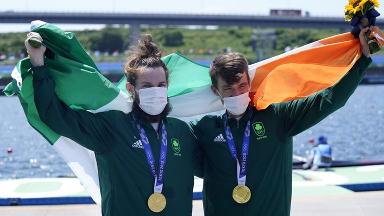 Paul O'Donovan and Fintan McCarthy celebrate making history by winning Ireland's first ever Olympic rowing gold medal