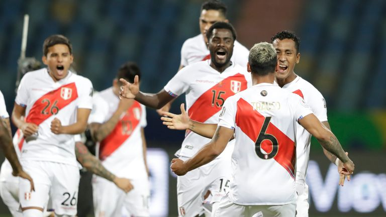 Peru's players celebrate after their Copa America quarter-final win over Paraguay