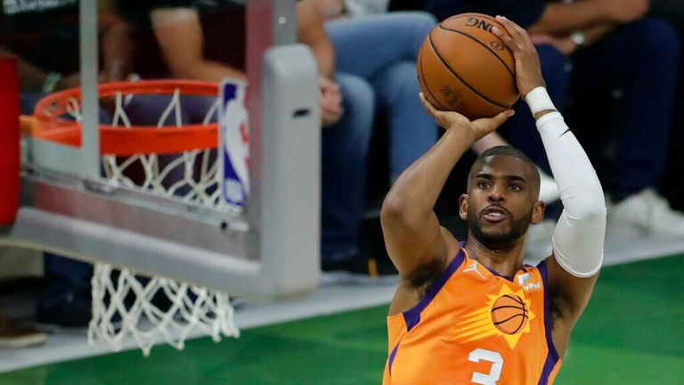 Phoenix Suns' Chris Paul shoots during the first half of Game 4 of basketball's NBA Finals against the Milwaukee Bucks Wednesday, July 14, 2021, in Milwaukee. (AP Photo/Aaron Gash)