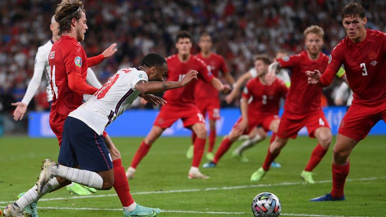 Raheem Sterling goes down to win England a penalty