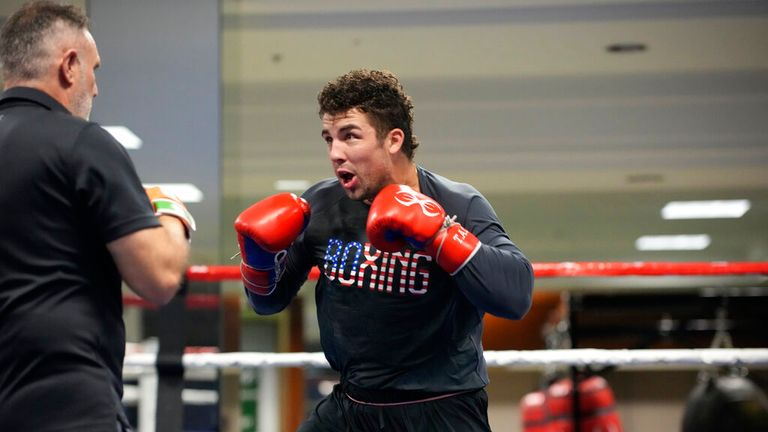 USA Boxing team member Richard Torrez Jr. spars with head coach Billy Walsh during a media day for the team in a gym located in a converted Macy...s Department store Monday, June 7, 2021, in Colorado Springs, Colo. (AP Photo/David Zalubowski)...................