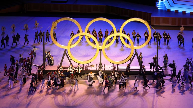 23 July 2021, Japan, Tokio: Olympics: Opening ceremony at the Olympic Stadium. Olympic rings are brought together during the show. Photo by: Jan Woitas/picture-alliance/dpa/AP Images