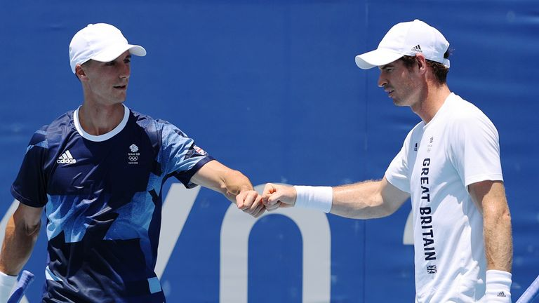 TOKYO, JAPAN - JULY 23: Andy Murray and Joe Salisbury of Team Great Britain fist bump during a practice session at Ariake Tennis Park ahead of the Tokyo 2020 Olympic Games on July 23, 2021 in Tokyo, Japan. (Photo by Clive Brunskill/Getty Images)