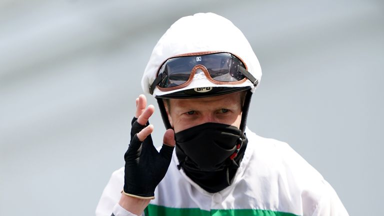 David Probert waves to the crowd after victory on Sandrine at Newmarket