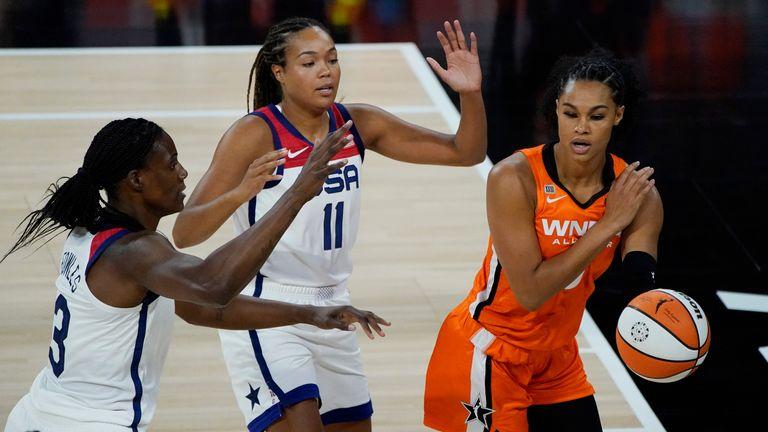 Team WNBA's Satou Sabally passes around United States' Napheesa Collier and Sylvia Fowles during the WNBA All-Star basketball game