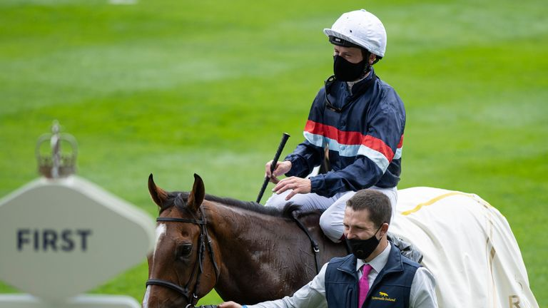 Oisin Murphy leads Sir Busker into the winner's enclosure at Ascot last year