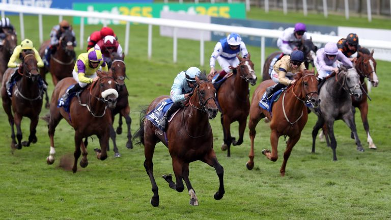 Starman comes through the field to win the July Cup
