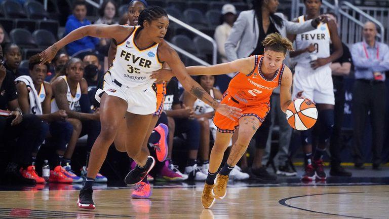 Connecticut Sun's Natisha Hiedeman is defended by Indiana Fever's Victoria Vivians