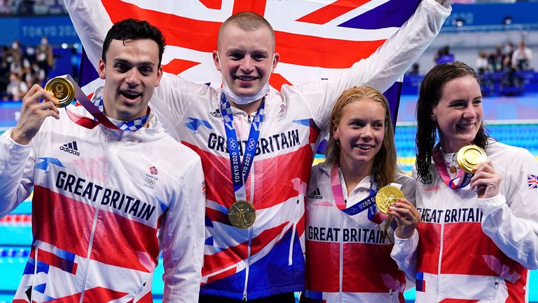 James Guy, Adam Peaty, Anna Hopkin and Kathleen Dawson pose with their gold medals