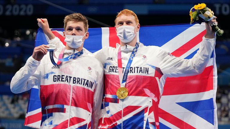 Gold medallist Tom Dean (R) poses with compatriot and silver medallist Duncan Scott after the men's 200m freestyle final