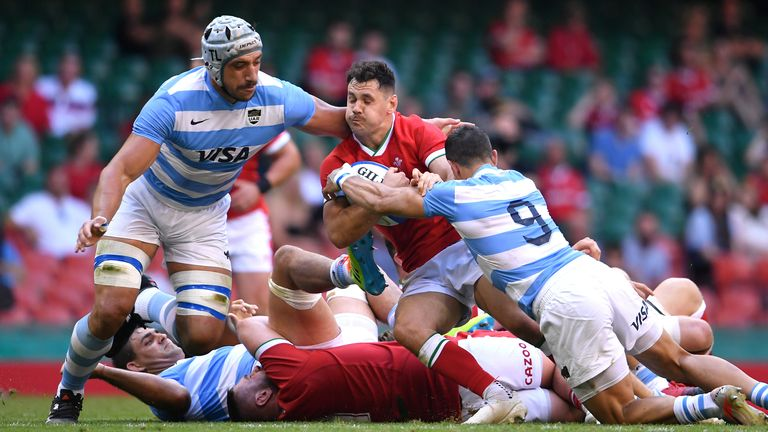 Wales' Tomos Williams is tackled by Argentina's Tomas Lavanini (left) and Tomas Cubelli