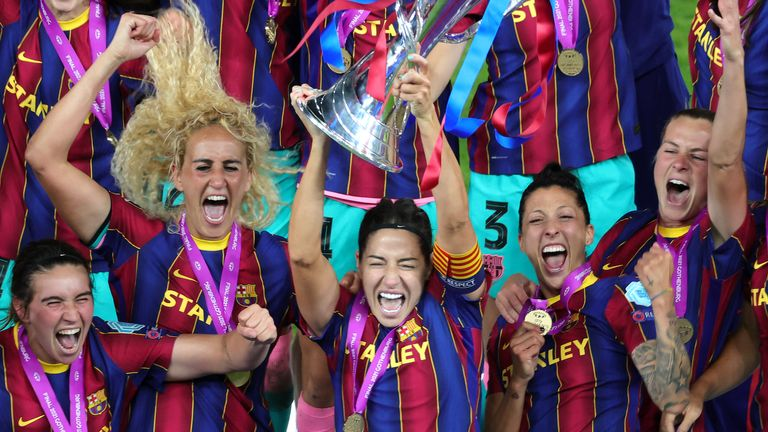 Barcelona's Vicky Losada lifts the trophy after victory in the UEFA Women's Champions League final