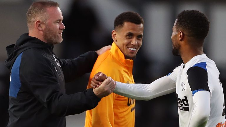 Derby boss Wayne Rooney with Ravel Morrison (centre) and Nathan Byrne (right)