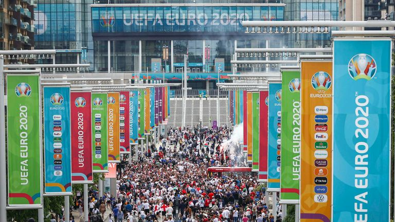 11 July 2021, United Kingdom, London: Football: European Championship, Italy - England, Final at Wembley Stadium. Numerous fans of England celebrate in front of the stadium in Wembley Park. Photo by: Christian Charisius/picture-alliance/dpa/AP Images