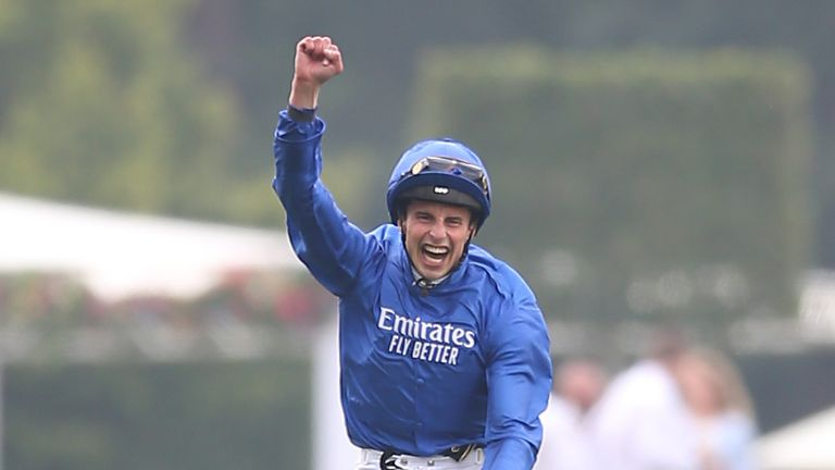 William Buick celebrates after Adayar's victory in the King George
