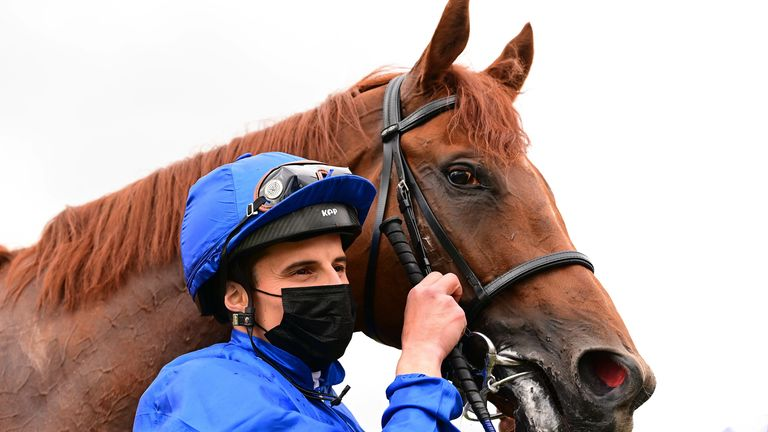 William Buick poses alongside Hurricane Lane after their victory in the Irish Derby last month