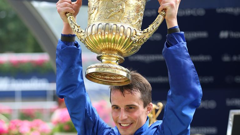 William Buick holds aloft the King George trophy after victory on Adayar