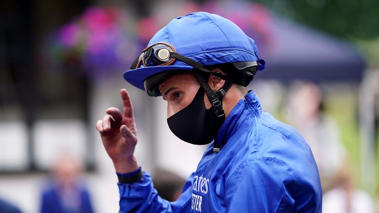 William Buick celebrates after victory on Royal Fleet at Newmarket