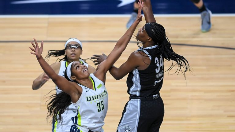 Minnesota Lynx center Sylvia Fowles (34) scores over Dallas Wings' Charli Collier (35) during the second half of a WNBA basketball game Wednesday, July 7, 2021, in Minneapolis.