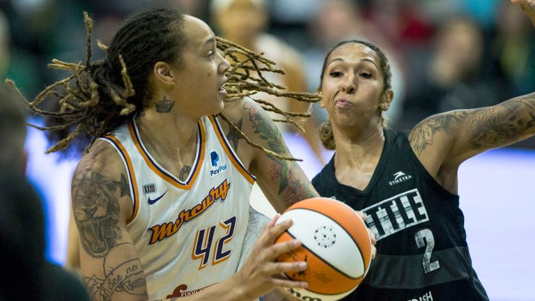 Phoenix Mercury's Phoenix Mercury's Brittney Griner tries to pass around Seattle Storm's Seattle Storm's Mercedes Russell during the first half of a WNBA basketball game Sunday, July 11, 2021 in Everett, Wash.