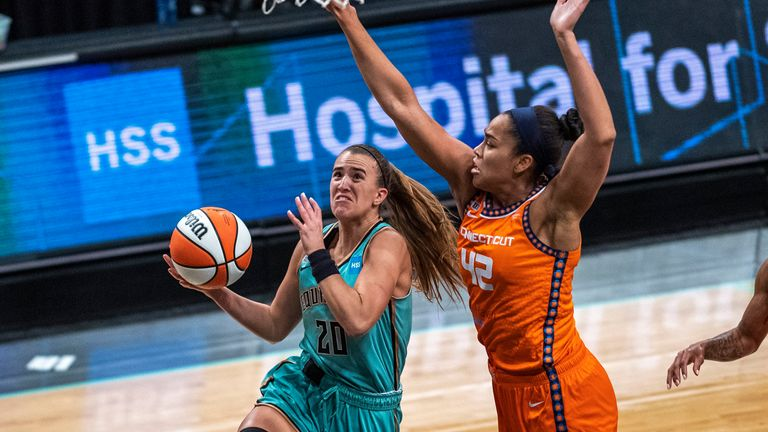 New York Liberty guard Sabrina Ionescu (20) attempts to shoot the ball as Connecticut Sun forward Brionna Jones (42) blocks it during the first half of a WNBA basketball game Sunday, July 11, 2021, in New York.