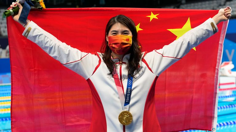 Zhang Yufei of China poses with the gold medal after winning the women's 200m butterfly final