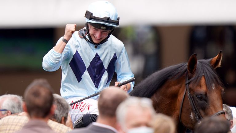 Jockey Tom Marquand celebrates after winning the Darley July Cup Stakes on Starman