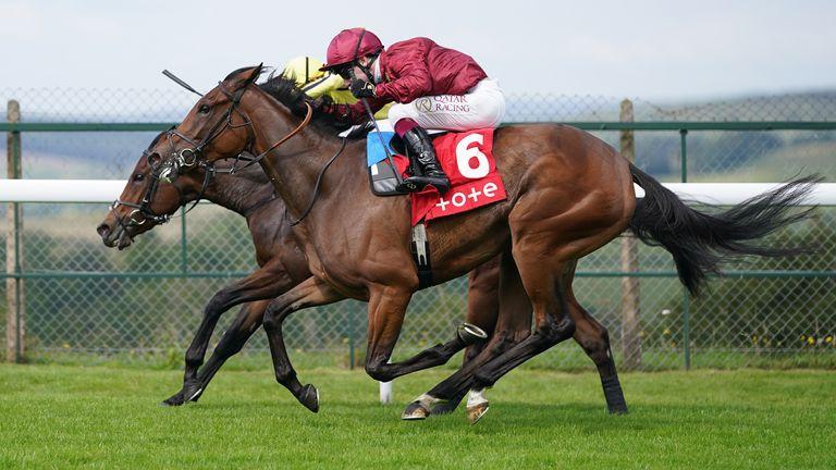 Mise En Scene ridden by jockey Oisin Murphy (right) winning at Goodwood
