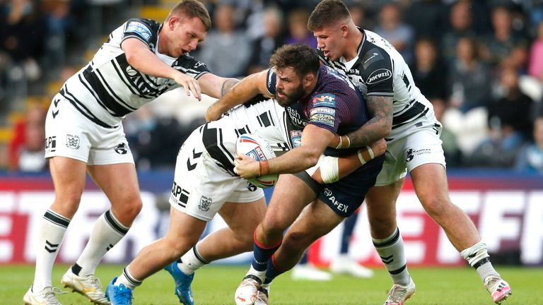 St Helens' Alex Walmsley takes on the Hull FC defence