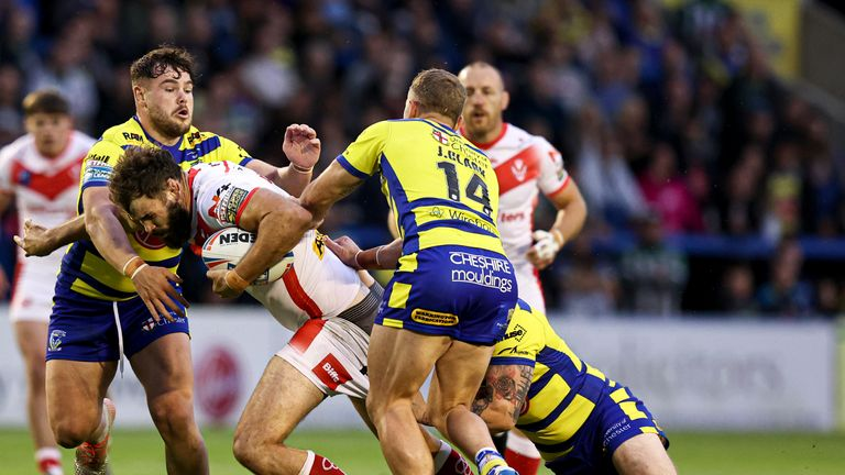 St Helens' Alex Walmsley is tackled