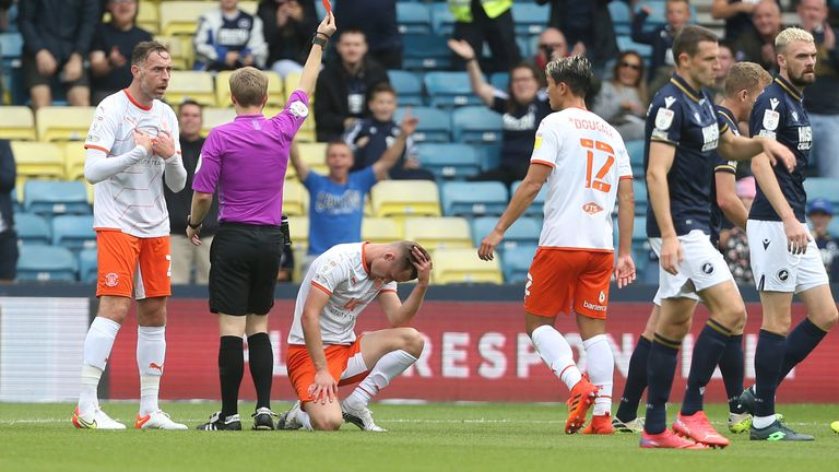 LONDON, ENGLAND - AUGUST 28: Blackpool's Callum Connolly is shown a red card during the Sky Bet Championship match between Millwall and Blackpool at The Den on August 28, 2021 in London, England. (Photo by Rob Newell - CameraSport via Getty Images)