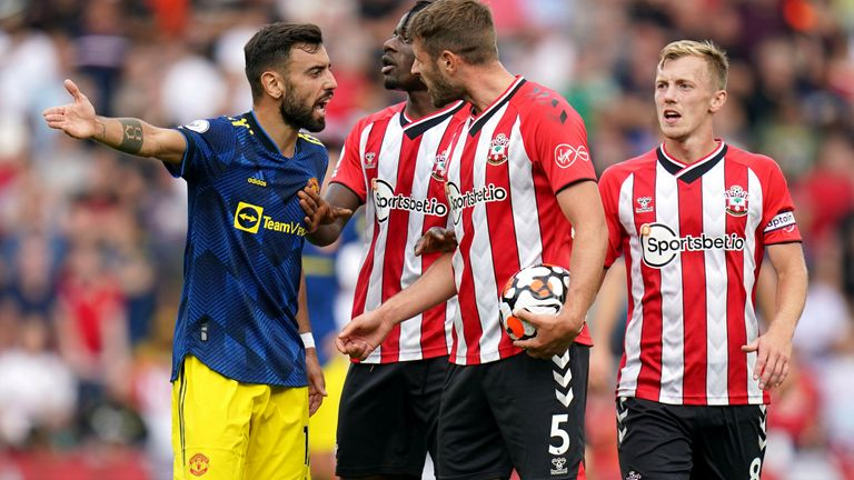 Manchester United's Bruno Fernandes (left) and Southampton's Jack Stephens (second right) clash during the Premier League match at St Mary's