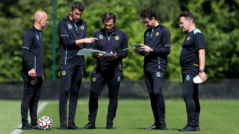 Alex Silva, Assistant Head Coach of Wolverhampton Wanderers, Bruno Lage, Manager of Wolverhampton Wanderers, Carlos Cachada, First-team fitness coach of Wolverhampton Wanderers, Luis Nascimento, Senior professional development coach of Wolverhampton Wanderers and Jhony Conceicao, Head of coaching strategy of Wolverhampton Wanderers look on during a Wolverhampton Wanderers Pre-Season Training Session at Sir Jack Hayward Training Ground on July 13, 2021