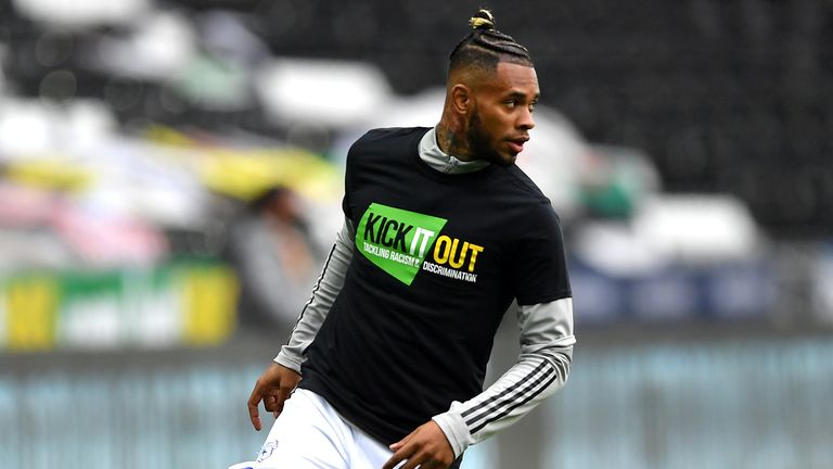Cardiff City's Leandro Bacuna wearing a shirt with the Kick It Out slogan earlier this year