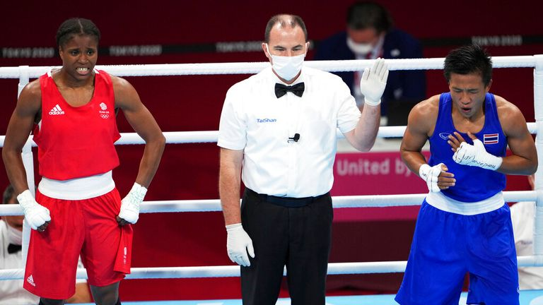 Thailand's SEESONDEE Sudaporn (R) reacts after winning the Boxing Women's Light (57-60kg) Quarterfinal against Great Britain's DUBOIS Caroline (red) and at Kokugikan in Tokyo on Aug. 3, 2021.( The Yomiuri Shimbun via AP Images )