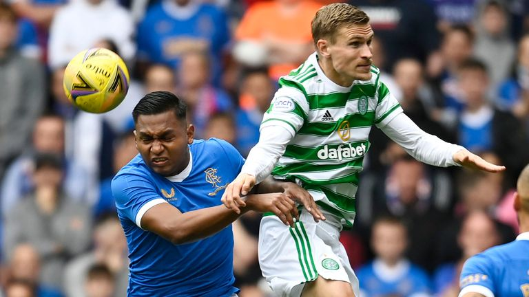 Rangers' Alfredo Morelos (left) battles with Celtic's Carl Starfelt during a cinch Premiership match between Rangers and Celtic at Ibrox, on August 29, 2021, in Glasgow, Scotland (Photo by Rob Casey / SNS Group)