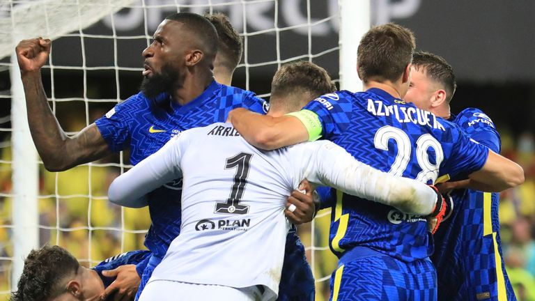 Chelsea's goalkeeper Kepa Arrizabalaga celebrates with team mates after the penalty shootout of the UEFA Super Cup soccer match between Chelsea and Villarreal at Windsor Park in Belfast,