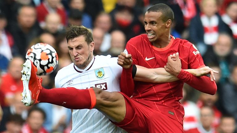 Chris Wood and Joel Matip battle for the ball - but Jurgen Klopp was unhappy with some challenges in the game between Liverpool and Burnley
