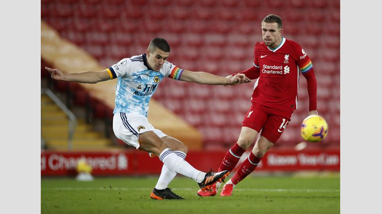 Liverpool v Wolverhampton Wanderers - Premier League - Anfield Wolverhampton Wanderers' Conor Coady (left) and Liverpool's Jordan Henderson battle for the ball during the Premier League match at Anfield, Liverpool. 6 December 2020
