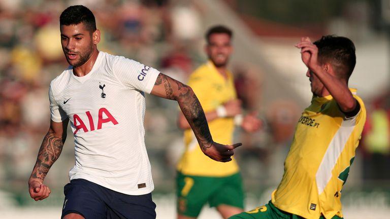 Pacos de Ferreira's Antunes Eustaquio, right, tries to tackle Tottenham's Cristian Romero